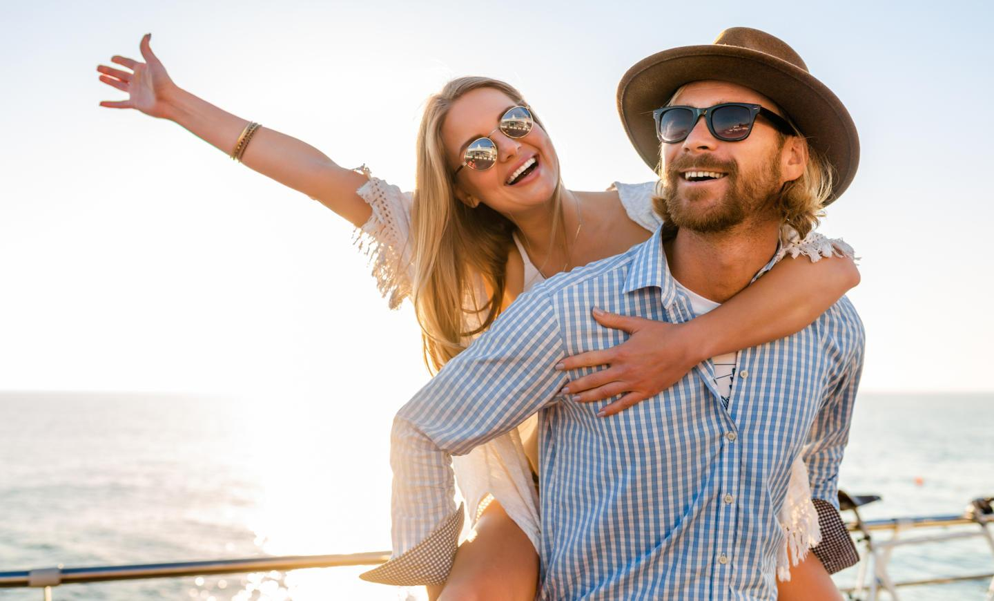 attractive-happy-couple-laughing-traveling-summer-by-sea.jpg